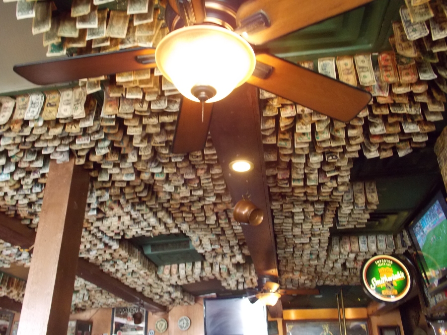 Dollars are markers of wishes at Lynch's Irish Pub-Picture by Rose Hammitt